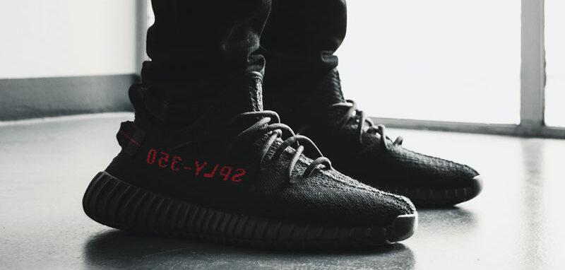 A pair of black Yeezy shoes