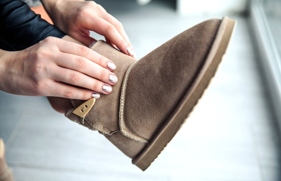 View of a woman wearing her UGG boots